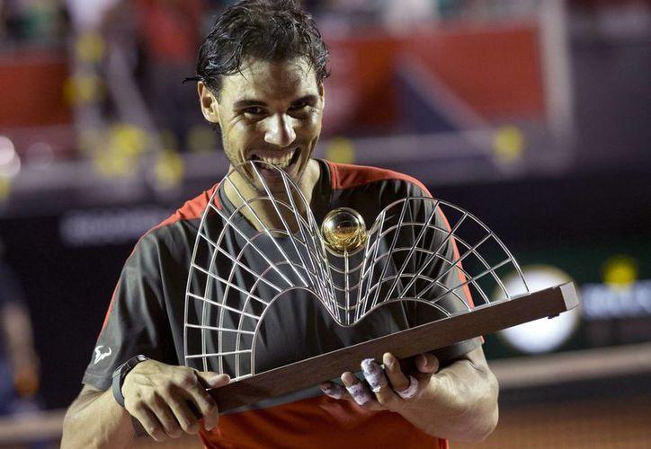 El tenista Nadal se agenció la primera edición del torneo de Río de Janeiro tras imponerse en la final a Alexander Dolgopolov, con lo que consiguió el título número 62 en su carrera. (Agencias)