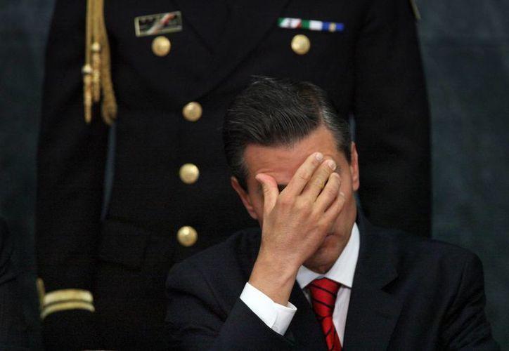 El gobierno de Peña Nieto ha resultado golpeado por una serie de escándalos, así como reportes de supuestas torturas y violaciones de los derechos humanos. (AP/Marco Ugarte)