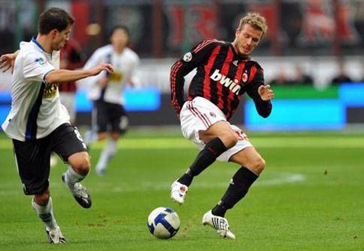 David Beckham se retiró jugando con Galaxy de Los Ángeles, y después compró parte de la franquicia de Miami de la MLS.(Archivo/AP)