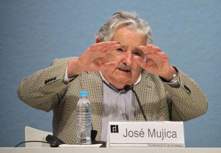"""El presidente de Uruguay, José Mujica, dijo que con su actuación """"quizás no cambiamos el mundo en el que vivimos, pero sentimos y multiplicamos nuestro compromiso con la sociedad"""". (Archivo/EFE)"""