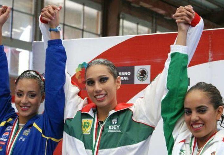 La yucateca Karen Achach fue parte del equipo ganador en nado sincronizado en los JJC. (Milenio Novedades)