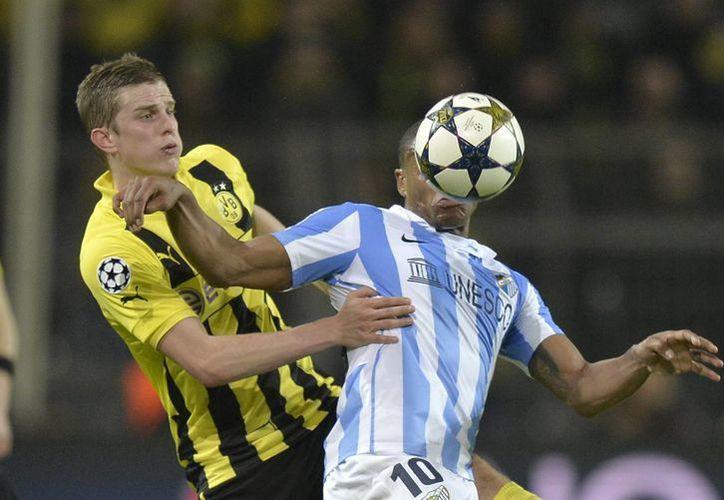 El Borussia Dortmund ganó por 3-2 al Málaga, dejándolo fuera de la Liga de Campeones. (Agencias)