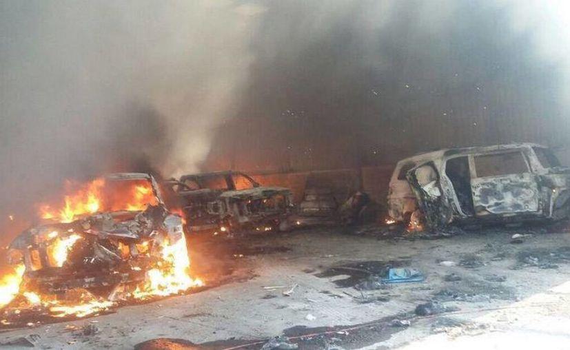 Luego de que el viernes un enfrentamiento en Tanhuato, Michoacán, dejó 43 muertos, este sábado los cuerpos fueron trasladados al Semefo. (ferriz.com.mx)