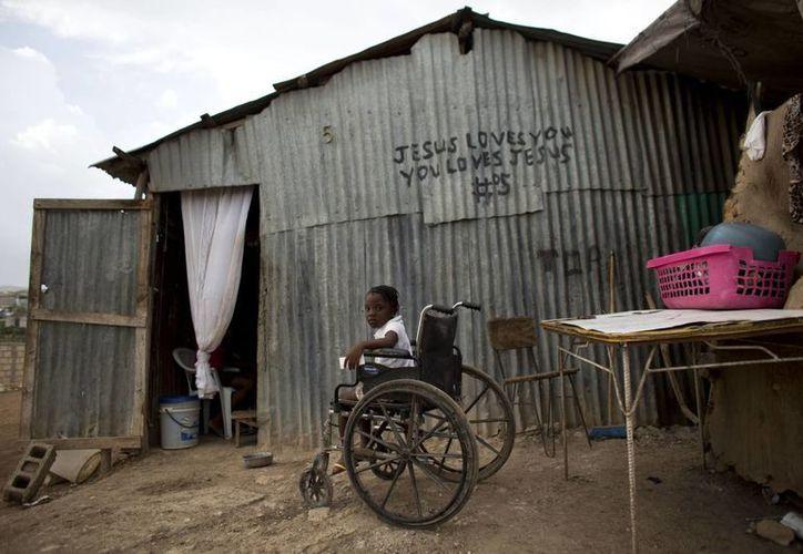 Algunos barrios de la empobrecida metrópoli de Caná, muy cercana a Puerto Príncipe, cuentan con guarderías y algunas tiendas, pero carecen se servicios básicos. (AP)