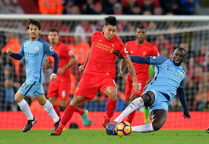 Con el triunfo ante el Manchester City, el Liverpool de Jurgen Klopp llegó a 43 unidades para ubicarse a 6 puntos del liderato.(Dave Howarth/AP)