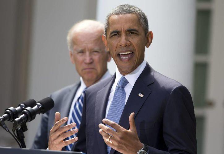 Barack Obama y Joe Biden, presidente y vicepresidente de EU, durante una conferencia para dar a conocer su postura sobre Siria. (Agencias)