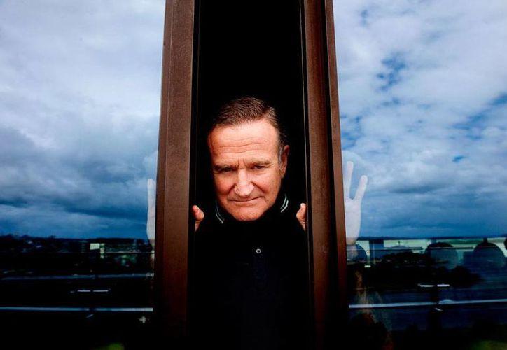 Robin Williams nunca quiso hablar de una de las enfermedades que padecía: mal de Parkinson, según reveló hoy su vuida Susan Schneider. Imagen de archivo donde se ve al actor posando en Sidney Australia. (Efe)