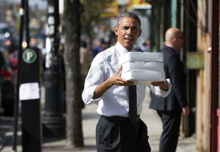 Los electores latinos reprueban la gestión del presidente Obama sobre la reforma migratoria. (AP)