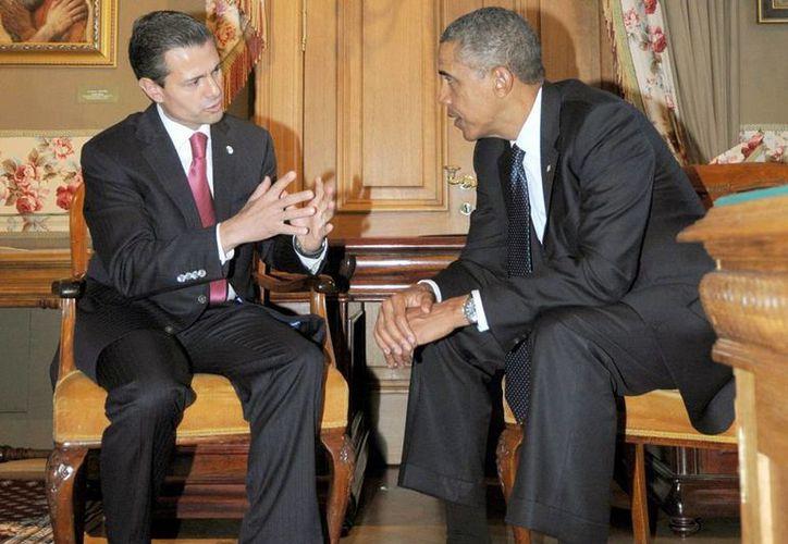 El presidente Enrique Peña Nieto en un encuentro con su homólogo de EU Barack Obama, en el marco de la cumbre de líderes del G20. (Notimex)