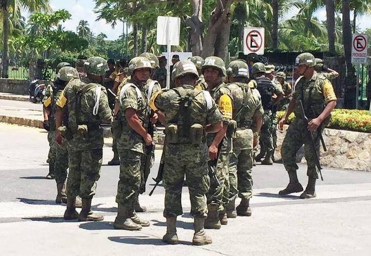 Piden que las Fuerzas Armadas participen y colaboren con la sociedad civil y seguridad pública en razón del tamaño y condiciones del adversario. (Archivo/Notimex)