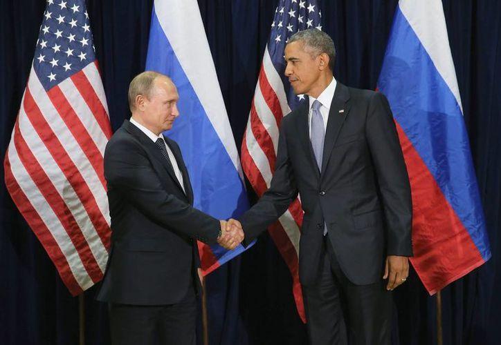 Los gestos de los presidentes de Rusia y Estados Unidos denotaban cierta tensión durante la reunión que sostuvieron en Naciones Unidas. (EFE)