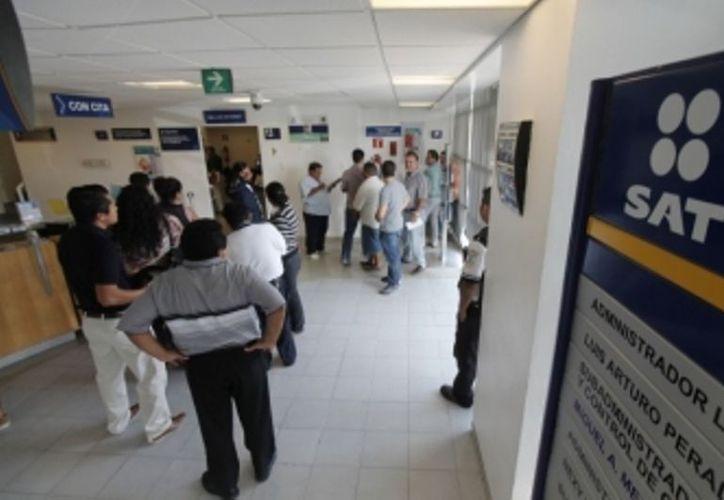 Cerca de 16 mil 600 contribuyentes chetumaleños han omitido acercarse al Servicio de Administración Tributaria (SAT) para realizar los trámites pertinentes. (Ernesto Neveu/SIPSE)