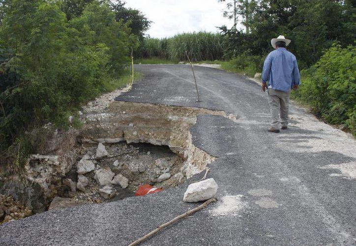 En cada temporada de lluvias los habitantes del poblado se ven en riesgo ante el incremento del nivel del río Hondo. (Harold Alcocer/SIPSE)