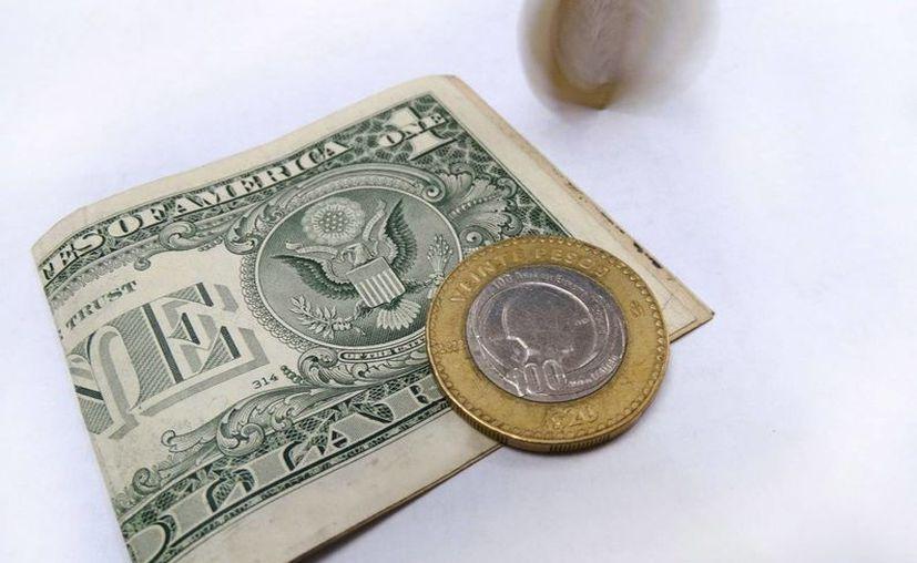 Los economistas coinciden en que la victoria de Trump en las elecciones presidenciales de EU resultaría 'desastroso' para la economía mexicana. (Archivo/SIPSE.com)