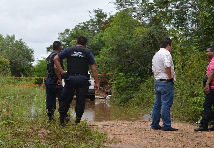 Los cuerpos del arquitecto y la maestra asesinados en 2013 fueron hallados en un camino de terracería. (Archivo)