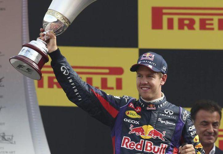 Vettel amplió su ventaja ante el español Fernando Alonso. (Agencias)