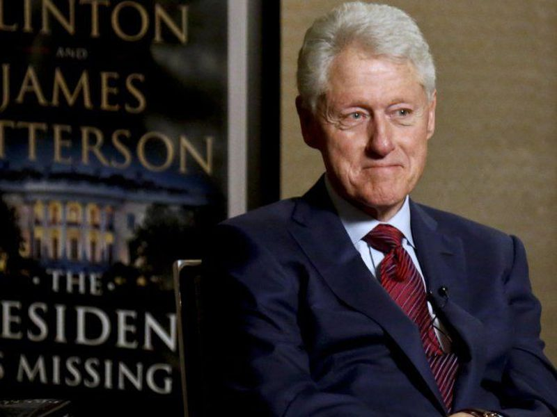 Former President Bill Clinton listens during an interview about a novel he wrote with James Patterson. (AP)