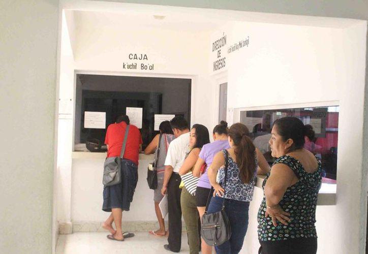 Solo el 55 % de los 11 mil 273 predios registrados en la zona maya ha cumplido con su pago. (Jesús Caamal/SIPSE)