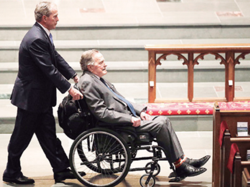 Former Presidents George W. Bush, left, and George H.W. Bush arrive at St. Martin's Episcopal Church for a funeral service for former first lady Barbara Bush. (AP).