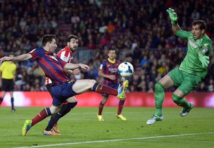 Con el triunfo sobre el Athletic, el Barza puso final a una semana trágica por la derrota en la fecha anterior en Granada y la pérdida de la Copa del Rey. (AP)