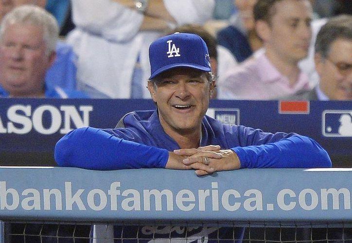 Mattingly cuenta con una marca de 260-225 en sus tres primeras temporadas con los Dodgers, a los cuales permanecerá ligado al menos hasta 2016.  (Agencias)