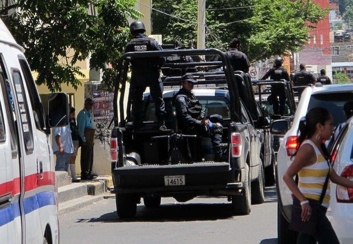 Las fuerzas policiacas resguardan fuertemente el puerto de Acapulco. (Notimex)