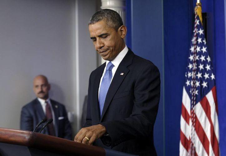 En su mensaje a las tropas, Obama lamentó la actitud del Congreso. (Agencias)