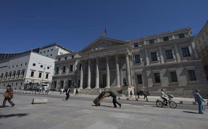 España podría ir por tercera ocasión a las urnas si el Congreso de los Diputados, cuya sede aparece en la imagen, no confima como presidente a Mariano Rajoy. (AP/Paul White)