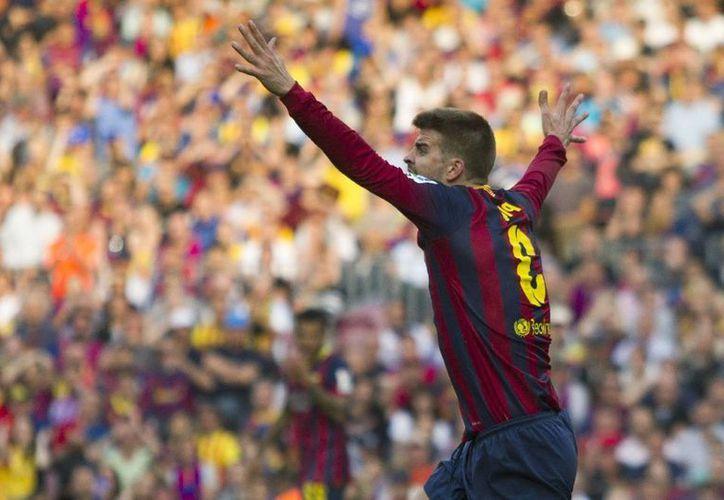 Piqué se formó en el Barcelona, se fogueó en el Manchester United y en 2008 regresó al club español, donde ha ganado dos ligas de campeones de la UEFA. (EFE)
