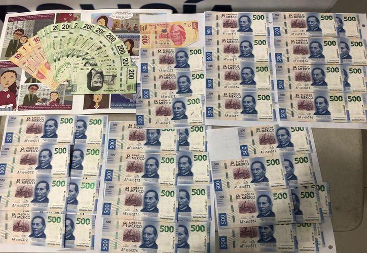 Elementos policíacos lograron asegurar 66 billetes falsos de diferentes denominaciones. (Redacción/SIPSE)