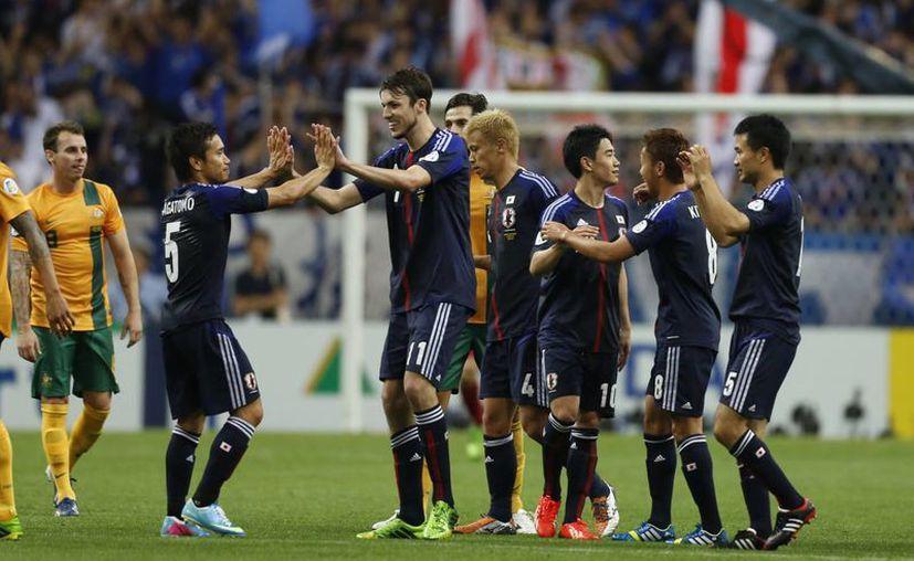 Japón requería de al menos un punto para alcanzar la meta: el Mundial 2014 y lo consiguió en los últimos minutos. (Agencias)