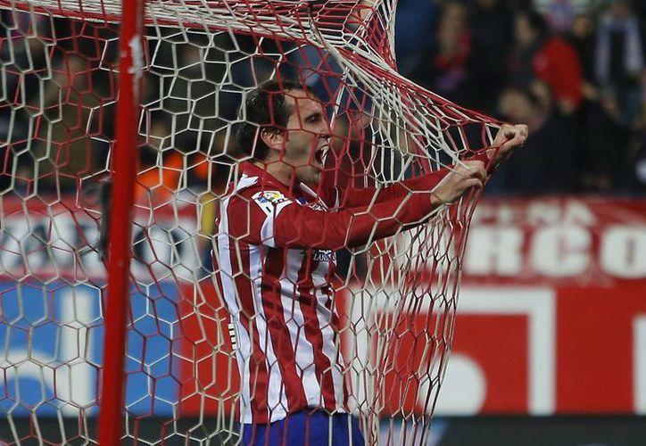 El uruguayo Diego Godín, zaguero del Atlético de Madrid, anotó el único gol del partido jugado ante el Athletic de Bilbao. (Agencias)