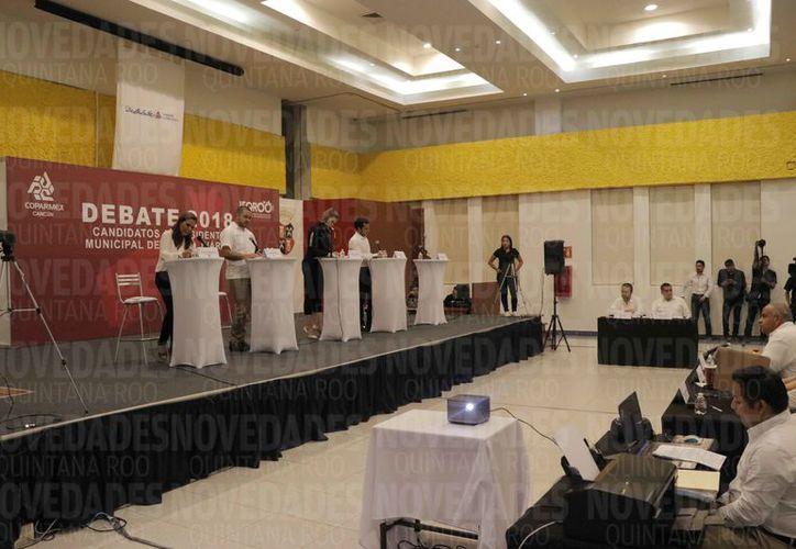 Participaron cuatro candidatos en el debate que fue organizado por la Coparmex. (Israel Leal/SIPSE)