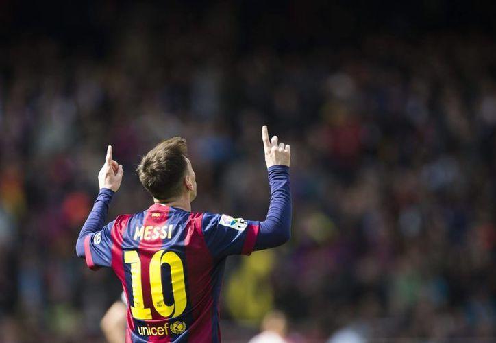 Lionel Messi muestra su alegría tras anotar el cuarto gol de su equipo frente al Rayo Vallecano. (EFE)