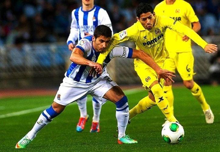 Se esperaba que el encuentro Real Sociedad y Villarreal fuera parejo con equipos dispuestos a triunfar, pero tuvieron mala puntería en zona de definición y pocas llegadas con peligro de gol. (villarrealcf.es)