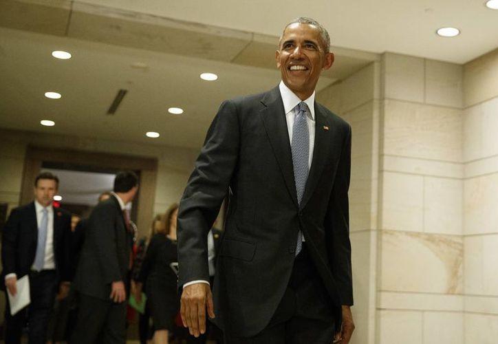 En la recta final de Obama se ha empezado a experimentar también una recuperación de las rentas familiares. (AP/Evan Vucci)