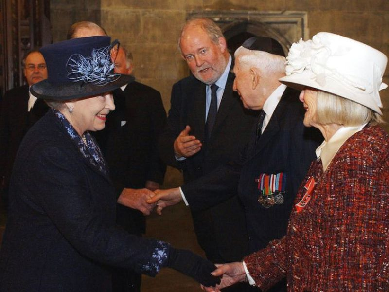 Britain's Queen Elizabeth II, left, meets Holocaust survivor Gena Turgel during a service to remember victims of the Holocaust.