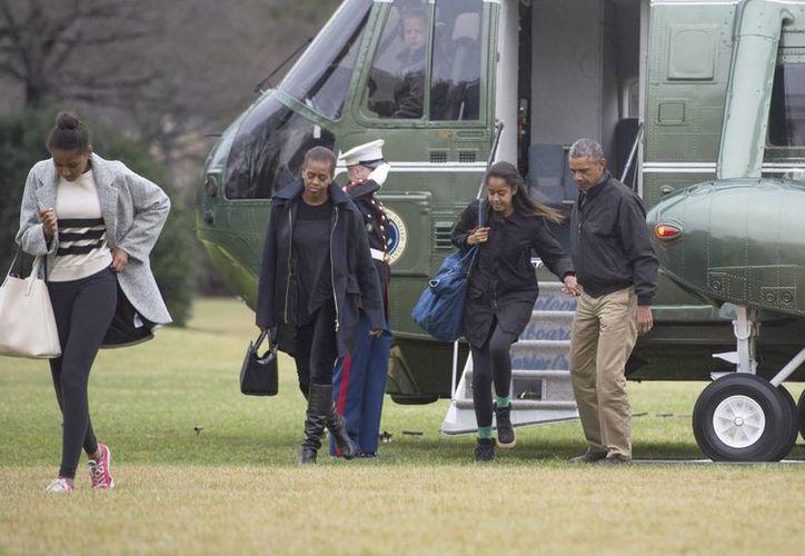 Obama pasó 15 días con su familia en Hawai. (EFE)