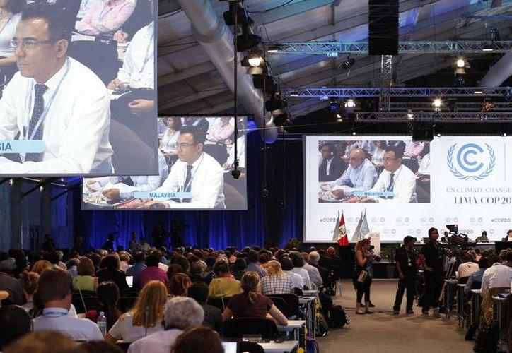 Delegados participan en la Conferencia de Cambio Climático de la ONU en Lima, Perú. (Agencias)