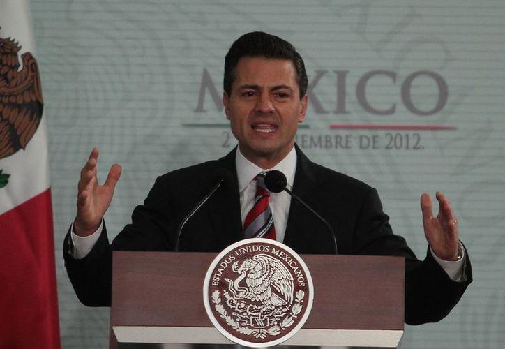 """La Arquidiócesis dice que Enrique Peña Nieto tiene trece propuestas para """"sacar al país del atolladero"""". (Archivo/Notimex)"""