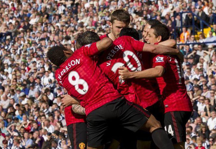Aunque fue una 'fiesta' de goles, el empate le supo a derrota a los red devils: ganaban 5-2. (Agencias)