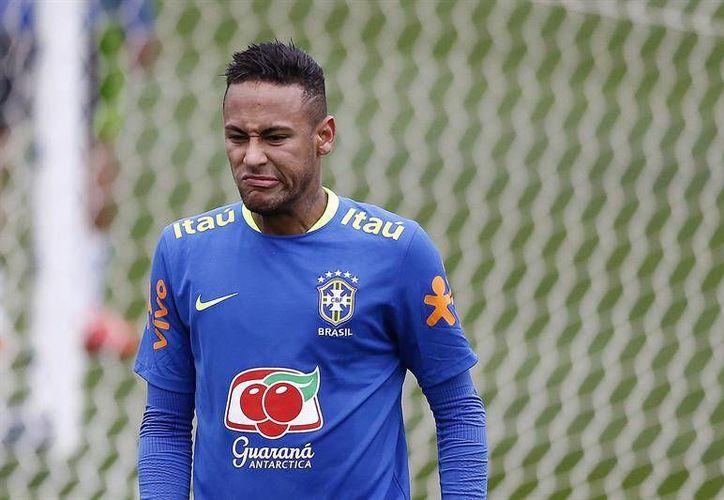 Neymar consiguió con Brasil la presea de plata en Londres 2014; ahora busca el máximo metal.  (EFE)