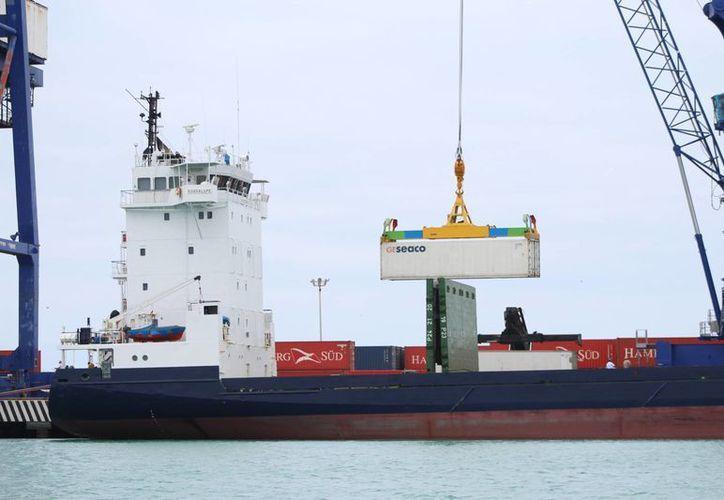 Este miércoles Progreso inauguró una ruta directa de exportación a través de la naviera Hamburg Süd, que tardaría 20 días en llegar a Marín España, 22 días hasta Amberes, 23 para llegar a Londres y 24 para Hamburgo. (Gerardo Keb/Milenio Novedades)
