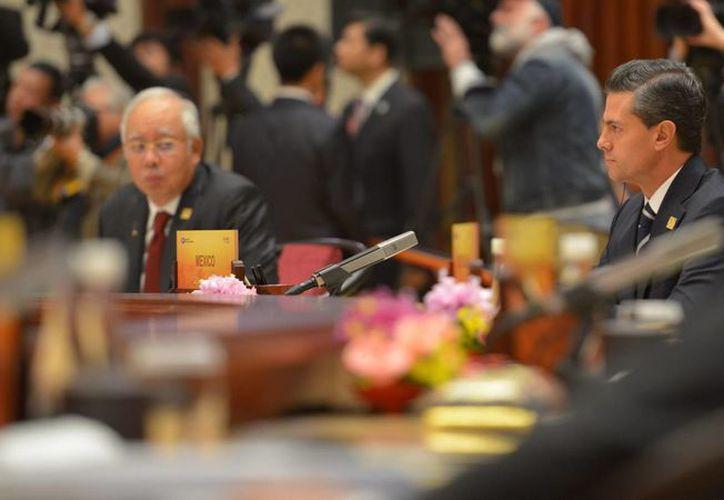 El presidente de México, Enrique Peña Nieto, ofreció un mensaje en la cumbre de líderes de la APEC en China. (Notimex)