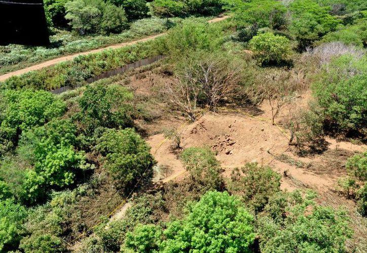 El meteorito cayó en una zona despoblada cercana al Aeropuerto de Managua la noche del sábado, dejando un cráter de unos 12 metros de diámetro. (EFE)