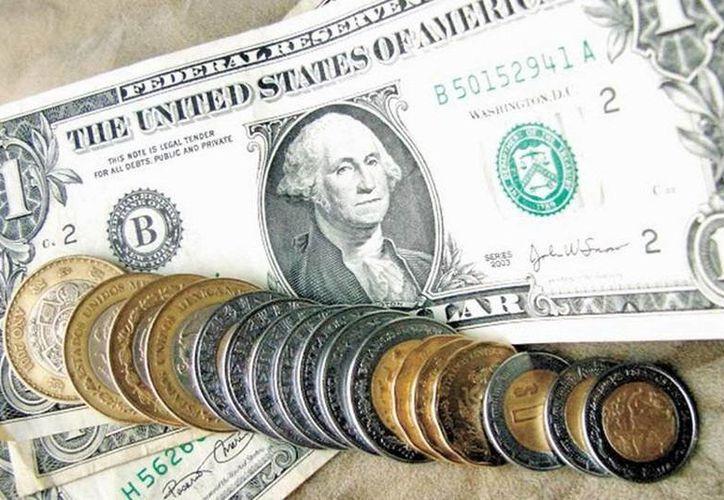 El día de hoy el dólar cerró en $18.73 a la venta en bancos de la Ciudad de México. (SIPSE)