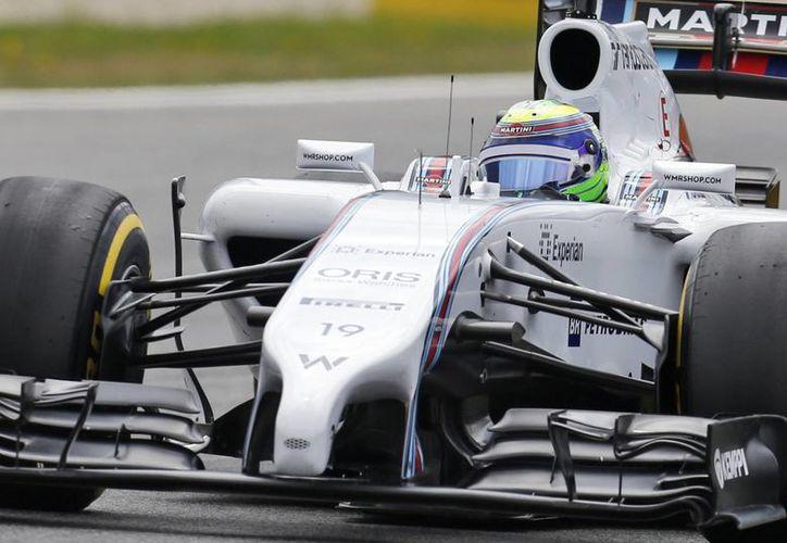 Felipe Massa obtuvo su decimosexta 'pole position' en su carrera. (AP)