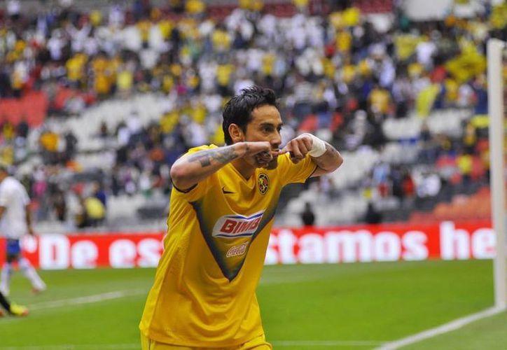 El héroe del partido, Rubens Sambueza, estuvo a punto de anotar un tercer gol, pero el poste lo impidió. (Agencias)
