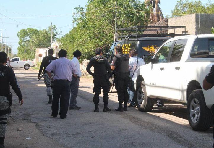 Este lunes se realizó en Temax la reconstrucción de los hechos violentos en los que murieron dos personas y tres más acabaron en el hospital, además de siete vehículos quemados. (SIPSE)