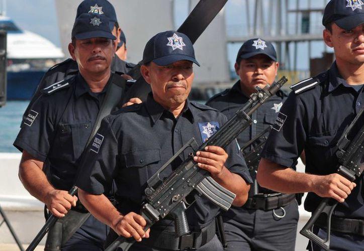Por falta de documentación o porque están a la espera de los resultados de la prueba de confianza, 50 elementos de Seguridad Pública no tienen permiso para portar armas.  (Gustavo Villegas/SIPSE)